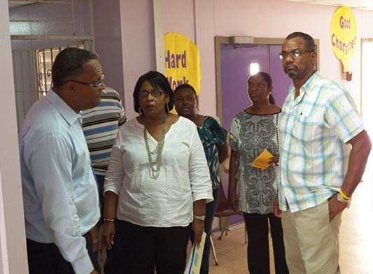 Education Minister the Hon. Jerome Fitzgerald is pictured with Minister for Grand Bahama, the Hon. Dr. Michael Darville and staff from the Bartlett Hill Primary School as they toured that facility on Friday morning. (BIS Photo / Simon Lewis)