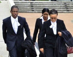 Shanique Myrie (back) and her legal team.
