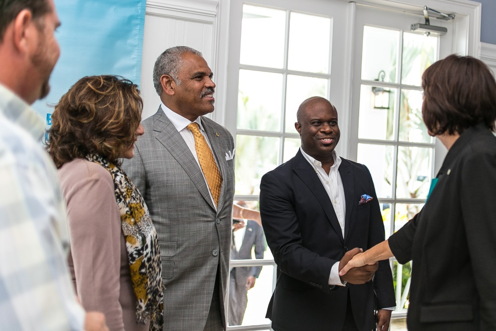 Chamber of Commerce CEO Edison Sumner welcomes Lisa Johnson, Charges d'affaires at the American Embassy, to the VIP event at Palm Cay. L-r, Zack Bonczek, Palm Cay, Diane Phillips, pr executive and Arnold Donald, President and CEO Carnival Corp. and guest of honour.