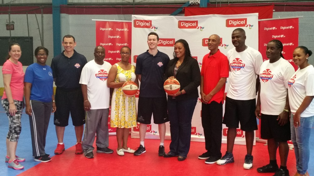 Hon. A. Missick (centre), Digicel Marketing Manager, Trina Adams (Far right), NBA Coaches, Chris and Adrian with local coaches