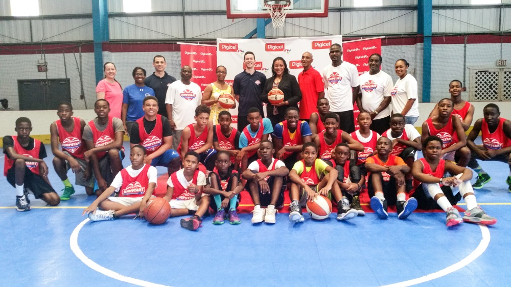 Min. of Education (Centre) with coaches and aspiring young players