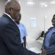Newly Sworn In Prime Minister, Dr.Hubert Minnis, speaks to one of the Custodians at the Office of the Prime Minister during a tour of the office