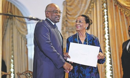Prime Minister Dr Hubert Minnis with Governor General Dame Marguerite Pindling at his swearing in ceremony.