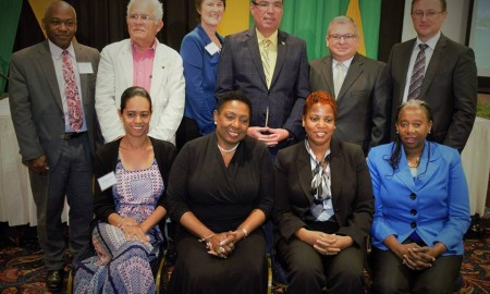 Government Ministers Olivia Grange and Daryl Vaz pose with a group of other attendees of a three-day symposium on World Heritage and Climate Change which opened at the Jamaica Pegasus on May 29. The Ministry of Culture, Gender, Entertainment and Sport is hosting the symposium. Others in the photograph are: (seated l-r) Melissa Marin Cabrera, Technical Officer, Livelihoods and Climate Change Unit, International Union for Conservation of Nature; Dr Janice Lindsay, Acting Permanent Secretary in the Ministry of Culture, Gender, Entertainment and Sport; Laleta Davis-Mattis, Chairman, Culture, Advisory Committee, Jamaica National Commission for UNESCO; (back row l-r) Vincent Sweeney, Head of the Caribbean Sub-Regional Office, UN Environment; Victor Marin, representing the International Council on Monuments and Sites (ICOMOS); Dr Brenda Ekwurzel, Director of Climate Science, Union of Concerned Scientists; His Excellency Bernardo Guanche Hernandez, Cuba's Ambassador to Jamaica and Yuri Peshkov, Cultural Programme Specialist, UNESCO Cluster Office.