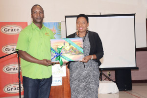 Janet Silvera John Lindo, chairman, MoBay Jerk Festival presents Minister Olivia 'Babsy' Grange with the gift of a Jamaican painting during the launch of the event. *** Local Caption *** Janet Silvera John Lindo, chairman, MoBay Jerk Festival presents Minister Olivia 'Babsy' Grange with the gift of a Jamaican painting during the launch of the event.