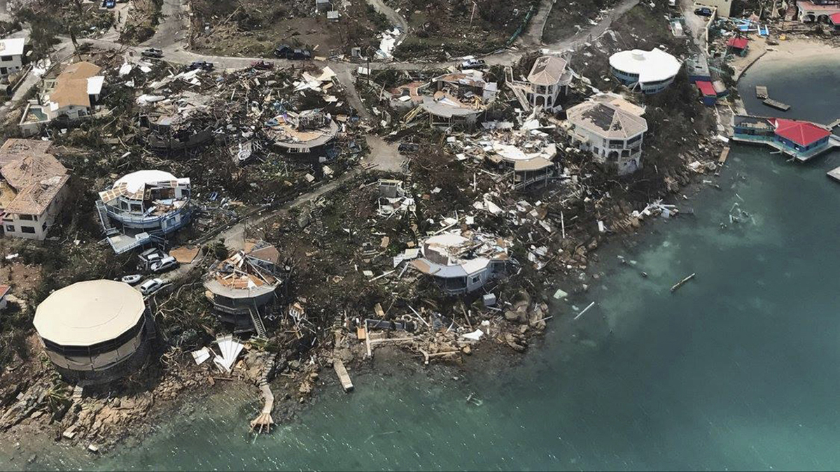 CORRECTS DAY - This photo provided on Friday, Sept. 8, 2017, shows storm damage in the aftermath of Hurricane Irma in Virgin Gorda's Leverick Bay in the British Virgin Islands. Irma scraped Cuba's northern coast Friday on a course toward Florida, leaving in its wake a ravaged string of Caribbean resort islands strewn with splintered lumber, corrugated metal and broken concrete. (Caribbean Buzz Helicopters via AP)