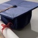 Scroll and mortarboard