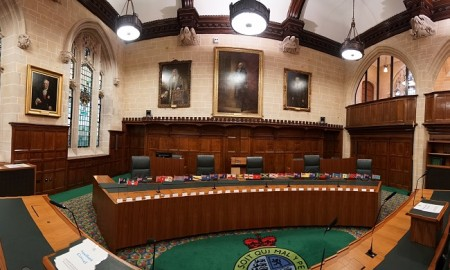 The Judicial Committee of the Privy Council (JCPC) is one of the highest judicial bodies in the United Kingdom. Established by the Judicial Committee Act 1833 (or with the Privy Council Appeals Act 1832) to hear appeals formerly heard by the King-in-Council (s. 3), it acts as the highest court of appeal (or court of last resort) for several independent Commonwealth nations, the British Overseas Territories and the British Crown dependencies.It is often referred to as the Privy Council, as in most cases appeals are made to 'Her Majesty in Council, who then refers the case to the Judicial Committee for 'advice'; the 'report' of the Judicial Committee is always accepted by the Queen in Council as judgment.   In Commonwealth republics retaining the JCPC as their final court of appeal, appeals are made directly to the Judicial Committee itself. In the case of Brunei, appeals are made to the Sultan of Brunei, who then refers the case to the Judicial Committee for advice.  Formerly the Judicial Committee gave a unanimous report, but since the Judicial Committee (Dissenting Opinions) Order 1966 dissenting opinions have been allowed.   The Judicial Committee holds jurisdiction in appeals from the following 31 jurisdictions (including twelve independent nations):  The Judicial Committee's permanent home is in London, in the United Kingdom. On 1 October 2009, it moved from the Privy Council Chamber, in Downing Street, to the former Middlesex Guildhall building, which had been refurbished in 2007 to provide a home for both the JCPC and the newly created Supreme Court of the United Kingdom. In this renovated building, Court 3 is used for Privy Council sittings.  The judicial system of the United Kingdom does not have a single highest national court; the Judicial Committee is the highest court of appeal in some cases, while in most others the highest court of appeal is the UK Supreme Court. (In Scotland the highest court in criminal cases is the High Court of