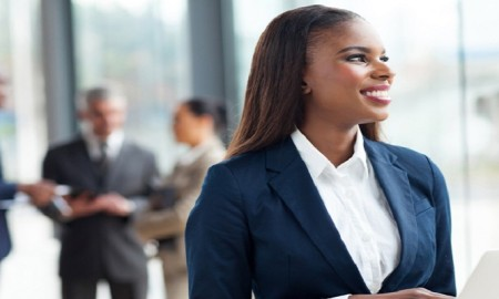 pretty african corporate worker using laptop